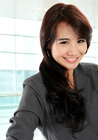 portrait of pretty business woman looking confident and smiling Stock Photo - 20580546