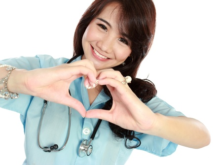 happy nurse: portrait of happy young nurse give you sign of heart shape Stock Photo