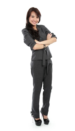 Casual business woman with arms crossed and smiling isolated over white background photo