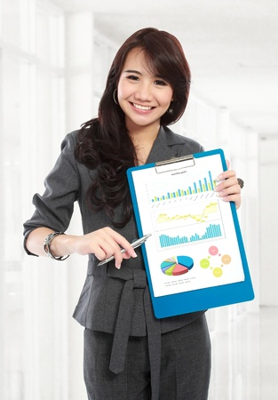 young business woman hold the paper for presenting Stock Photo - 20581665