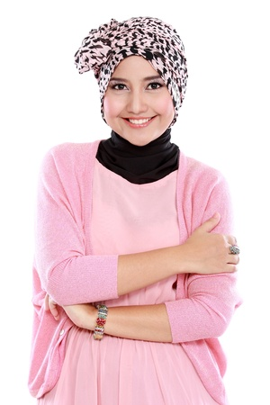 Young asian muslim woman in head scarf smile with arms crossed