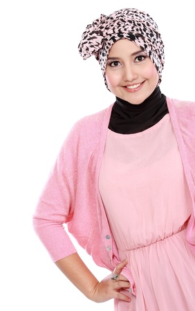 Young asian muslim woman in head scarf smile isolated over white background photo