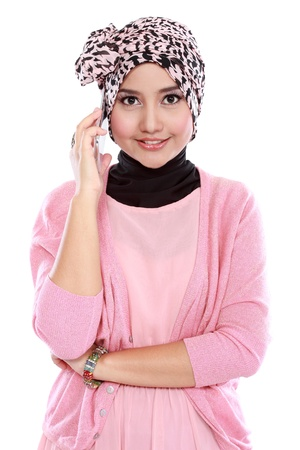 Portrait of a successful asian muslim woman calling by phone and looking at camera photo