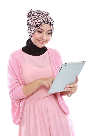 Beautiful young woman using tablet computer isolated over white background photo