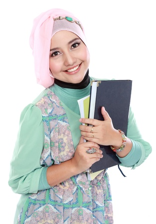 Portrait of happy muslim student portrait holding a few books isolated over white background photo