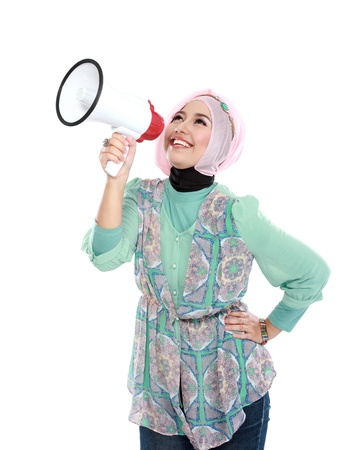 Young attractive muslim woman shouting using megaphone isolated over white background Stock Photo - 20914576