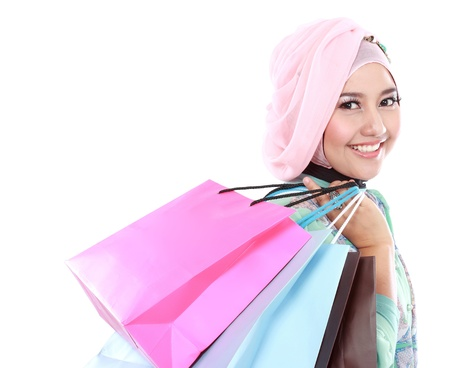 lifestyle looking lovely: Portrait of a beautiful young muslim woman, in a holding in her hands a few shopping bags