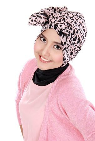 Portrait of a happy young asian muslim woman in action and looking at camera photo