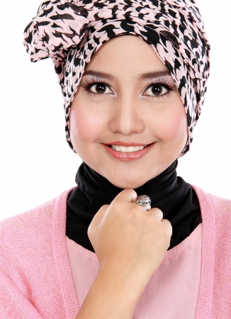 Closed up of young asian muslim woman in head scarf smile photo
