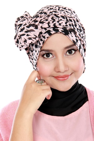 Closed up of smiling young asian muslim woman in head scarf smile photo