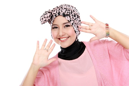 Happy of young asian muslim woman in head scarf smile isolated over white background photo