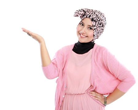 Portrait of a young muslim woman showing blank area for sign or copyspace photo