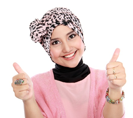 thumbsup: Attractive woman giving thumbs up isolated over white background