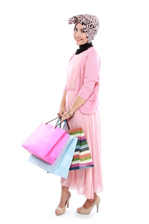 Happy young woman with shopping bag isolated over white background Stock Photo