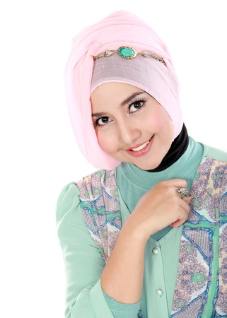 Portrait of a happy young muslim woman in action and looking at camera Stock Photo