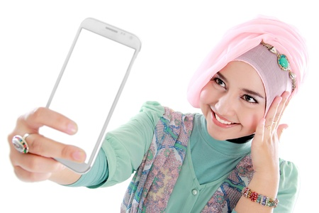 Happy young muslim woman take self portrait with handphone photo
