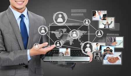 shows: Portrait of business man with laptop showing social connected on a virtual background Stock Photo