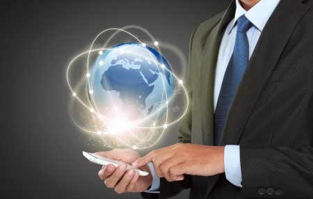 businessman navigating in virtual reality interface with mobile phone Stock Photo