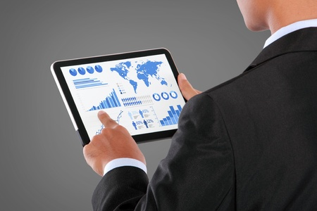 man pushing on a touch screen tablet PC infographics Stock Photo - 21910975