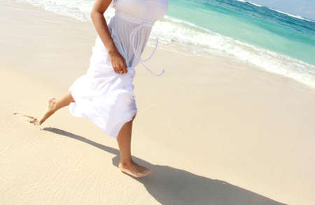 Portrait of woman's foot while running on the beach Stock Photo - 21911624