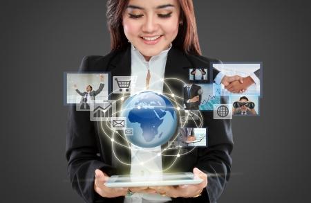 若い実業家バーチャルリアリティ インターフェイス内を移動します。 写真素材