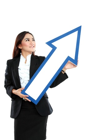 picture of smiling businesswoman with direction arrow sign on white background photo