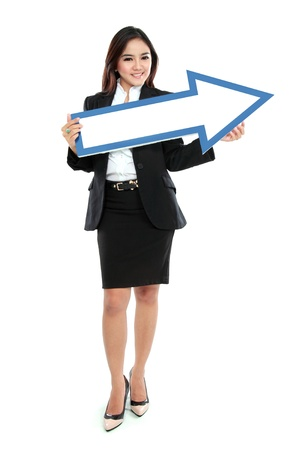 directing: smiling businesswoman with direction arrow sign on white background