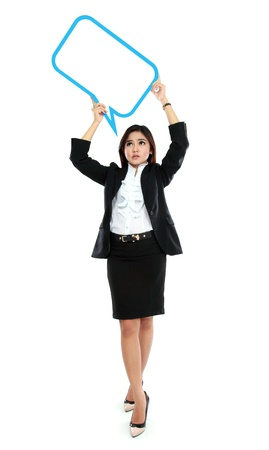 full lenght: Picture of full lenght business woman holding blank text bubble in specs over head on white background