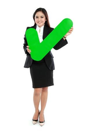 full lenght: Full lenght of businesswoman holding check mark sign on white background Stock Photo