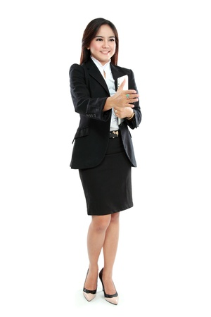 Portrait of businesswoman holding tablet computer and hand out to handshake isolated over white background photo