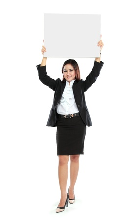 above head: Portrait of beautiful businesswoman holding blank billboard over her head. Isolated on white background