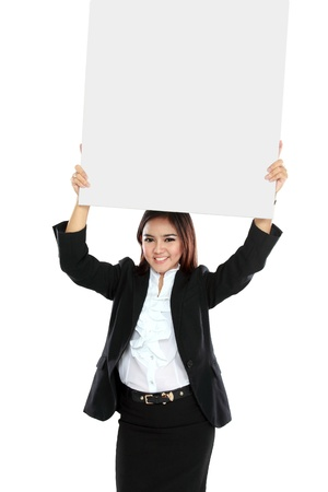 Portrait of beautiful businesswoman holding blank billboard over her head. Isolated on white background photo