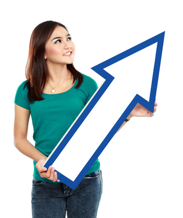 profitability: Portrait of young girl with arrow sign