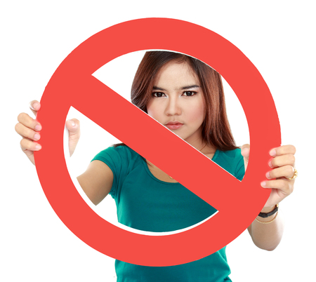 Close up of young woman holding prohibited sign Stock Photo - 22435455