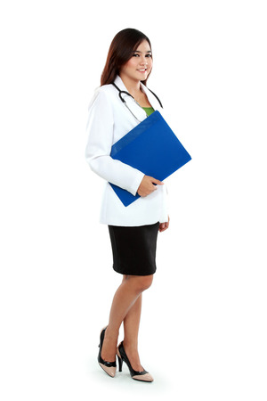 Full body asian female medical doctor holding a clipboard standing  photo