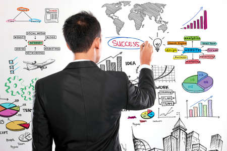 Businessman drawing modern business concept on white photo