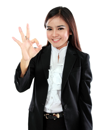 okay sign: Business asian woman with ok hand sign over white background Stock Photo