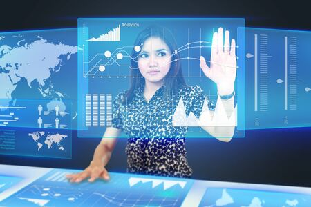 Businesswoman dragging an icon on a touch screen monitor. conceptual image photo
