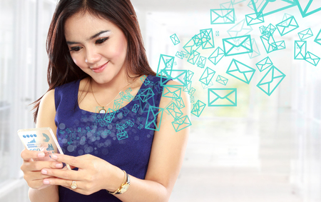 communicating: Portrait of young asian woman texting message