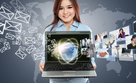 Portrait of businesswoman using laptop and showing communicating with his team across the world. International communications concept photo