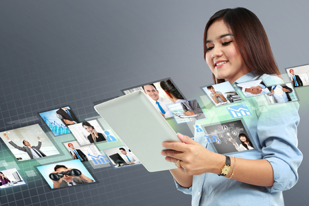 woman tablet pc: Portrait of successful young woman with tablet on virtual background