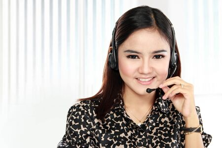 Friendly help desk woman smiling call center operator phone. headset Stock Photo - 22535647