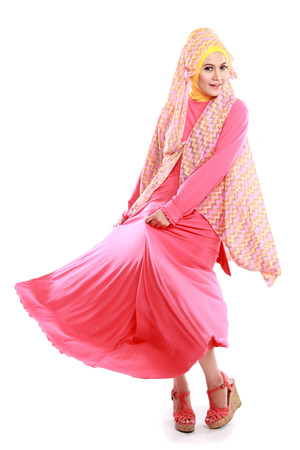 beautiful girl wearing pink muslim costume