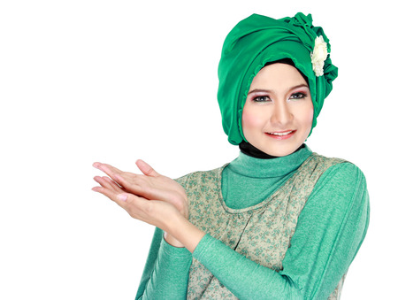 promotion girl: Portrait of beautiful young moslem woman presenting  Stock Photo