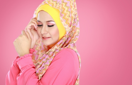 girl in dress: Fashion portrait of young beautiful muslim woman with pink costume wearing hijab