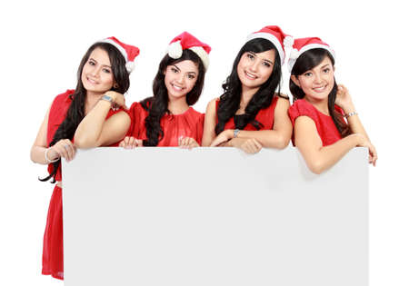Happy funny people with christmas santa hat holding blank banner and showing on white  photo