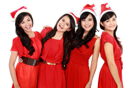 Happy young four asian woman with christmas santa hat isolated  on white  photo