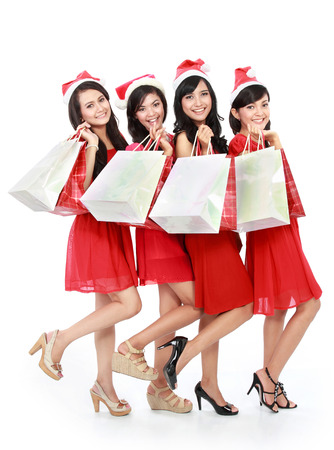 Portrait of happy funny people with christmas santa hat holding gift boxes photo