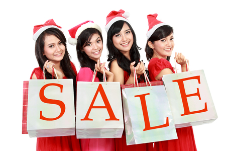 Picture of beautiful four asian women in red dress with shopping bag isolated on white  photo