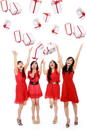 Happy funny beautiful women with boxes. Christmas. Party. Isolated over white  photo